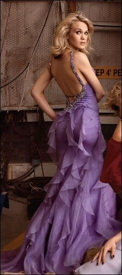 Carrie Underwood in a purple low back prom dress 2014